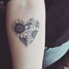 20 More Magnificent Sunflower Tattoos: This design showcases two sunflowers overlapping each other in a heart shape. #flowertattoo; #tattoo; #tattooart; #tattoodesign