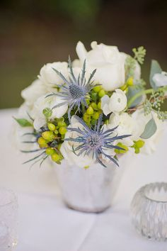 white rose, blue thistle, green hypericum berry and seeded eucalyptus wedding centerpiece | photo: corbingurkin.com | event design, coordination and floral design: loluma.com