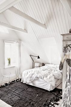 COCOCOZY: SWEDISH DECOR DELIGHT - INSTAGRAM WORTHY HOUSE - fresh white and gray bedroom...with a cute white wire Bertoia chair.  Love the exposed beams and slanted roof line.  Makes it cozy