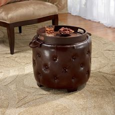 Bombay® Windsor Ottoman with Serving Tray Lid - Bombay® Windsor Ottoman with Serving Tray Lid offers a unique design that provides ample storage space within. Round tufted ottoman is made with chocolate brown faux leather upholstery. Lid flips over to a handled wood tray for serving snacks and beverages. Wood tray has a walnut finish.