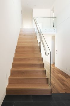 American Oak | Stained | Timber | Boxed Stair | Stainless Steel Handrail | Simple | Glass Balustrade | Distinctive | Contemporary