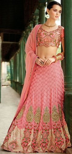 Radiate an aura of freshness and beauty with this salmon shade banarasi silk choli skirt. The moti, patch, resham and stones work looks chic and best for any get together. Wedding Chaniya Choli, Bridal Lehenga Choli, Ghagra Choli, Ethnic Fashion, Look Fashion, Indian Fashion, Lehenga Sari, Anarkali, Pink Lehenga