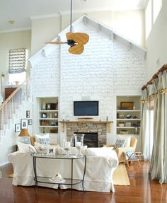 Cape Cod Cedar Shakes | The stacked stone fireplace with rough-hewn mantel adds to the family room's relaxed, cozy, coastal feel.
