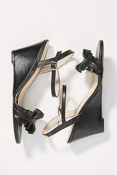136dc9200a57 Elysess Ruffled Wedge Sandals - Anthropologie - Black Heeled Wedges  Featuring a just-high-enough wedge and a ruffled toe strap