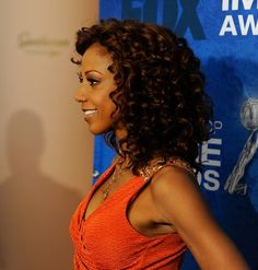 Holly Robinson Peetes curly hairstyle