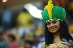 A young supporter poses ahead of the Group A football match between Cameroon and Crotia at the Amazonia Arena in Manaus. Photo-Raphael Alves