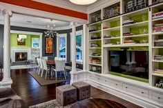 The Living  Dining  and Family Rooms open into each other and are trimmed by bright white trim for a fresh and dramatic appearance  http   jwphoto com  #livingdesign