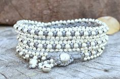 Items similar to Brass Or Silver Beaded Triple Wrap Grey Unisex Bracelet on Etsy Handmade Bracelets, Beaded Bracelets, Triple Wrap, Bead Weaving, Silver Beads, Bracelet Making, Wax, Dangles, Brass