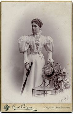 Lady Holding Straw Hat, 1890s.