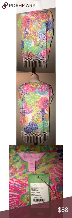 Lilly Pulitzer $88 OBO Sz M/L Jasmine Caftan Tunic Caftans are resort essentials. From beach day to beach bar afternoon...it's the ultimate cover-up. Caftans can also be paired with white denim for an easy daytime look with flats or casual evenings in wedges. Our newest Jasmine Caftan has the on trend fringe and colorful print to make it iconically Lilly. Caftan With Fringe Detail. Fine Viscose-Printed (100% Rayon). Hand Wash Cold. Imported. Lilly Pulitzer Tops