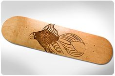 laser engraved skateboard with 3D scale pattern