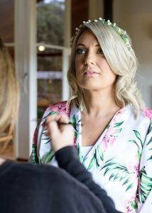 Finishing touches to bride's makeup