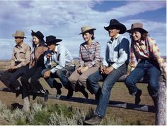 cowboys and cowgirls watching a bronco contest in Lander, Wyoming (1945 by B. Anthony Stewart)