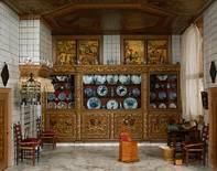The Best Kitchen with custom porcelain from China & Japan, plus hanging parrot cage - Petronella Oortman