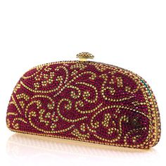 This breathtaking pink and gold Swarovski Crystal Evening clutch features a lovely, swirling floral design. It's one of a kind. Shoulder Chain Strap Included. - Genuine Swarovski Crystals - Hand Paint