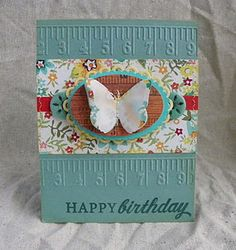 butterfly card tape measure embossing. I think I need this embossing folder.  :)