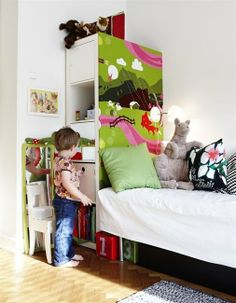 Storage doubles as headboard. Try without painting for adult room