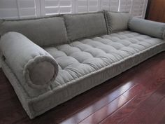 Custom French Mattress Cushion with matching lumbar pillows and bolster pillows, hand-tufted and made with comfortable yet supportive upholstry grade shredded loose foam and durable gray upholstery velvet fabric called Storm. This Custom Bench cushion makes a wonderful daybed mattress, window seat