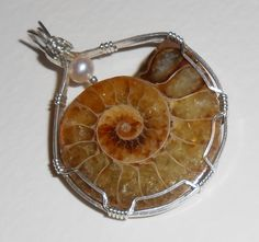Your place to buy and sell all things handmade Shell Jewelry, Glass Jewelry, Metal Jewelry, Jewelry Art, Jewelry Ideas, Jewellery, Wire Wrapped Necklace, Wire Wrapped Pendant, Fossil Jewelry