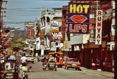 Olongapo, Phillipines in the late Spent a fair amount of time on this street in Regions Of The Philippines, Manila Philippines, Olongapo, Filipino Culture, Filipino Art, Uss America, Subic Bay, Navy Day, Royal Australian Navy