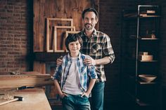 Portrait of charming magnificent dad kid child hug embrace piggy-back touch shoulders bearded garage craftsmen checkered shirt indoors industrial interior Interior Photo, Father And Son, Image Now, Photo Library, Craftsman, Hug, Dads, Bomber Jacket, Men Casual