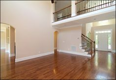 Open great room with balcony overlook and two story barrel vault foyer.