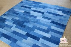 Denim quilt...great for picnic or to cover car seats. Save those old jeans.: