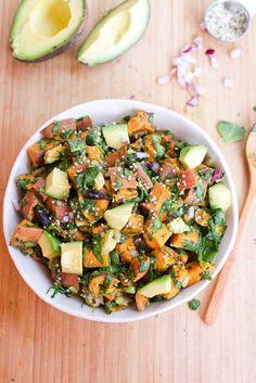 Roasted Sweet Potato Salad - Coconut oil roasted sweet potatoes tossed with chopped spinach, creamy avocado chunks, red onion and dried cranberries. Perfect for lunches and summer BBQs.