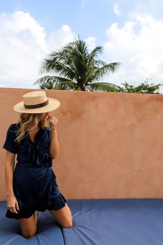 straw brim hat + a navy blue dress