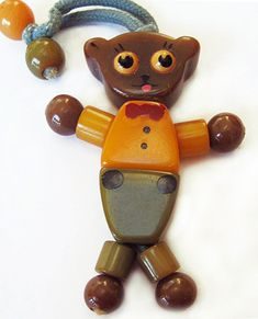 Bakelite Bear Crib Toy: Bakelite is the trade name for a castable, flame-resistant plastic invented by Leo Baekeland in 1909.