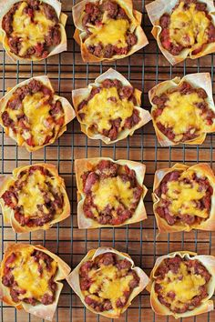 These Chili Wonton Cups are easy, meaty, spicy, and perfectly portioned for a meal or football snack! Just 124 calories or 3 Weight Watchers SmartPoints! www.emilybites.com