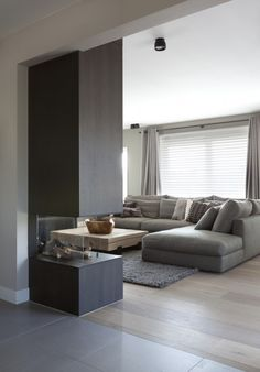 <3 white & grey memories blog <3. Love the extension of the 'wall' created for a modern fireplace.
