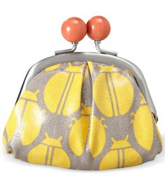$25   Coin Purse    Covered in bright beetles, this coated canvas pouch is, well, cute as a bug. (fossil.com)