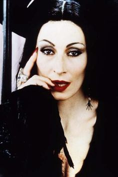 Anjelica Houston as Morticia  ( they taped her eyes up & back into her hairline)