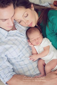 newborn with mom and dad (wish i looked that well-rested when we had our newborn--hah!!)