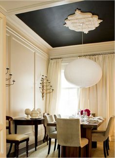 Thinking about painting my living room ceiling navy and leaving the walls their current cream color, to highlight the molding.