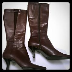 "Bandolino Brown Leather Boots Style and comfort make these chocolate brown leather boots a ""must have."" Leather upper with a slight suede strip on one side and buckle up top for design. Size:7M  Approximately 2 1/2""heel. Zipper closure. In good condition. Bandolino Shoes Heeled Boots"