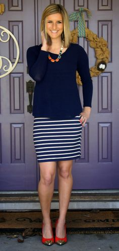 Love everything about this look -- flats with a pop of color, solid and comfortable top and fun skirt.