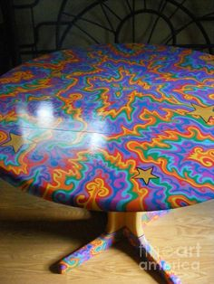 Table decorated with Oil Based Sharpie, then protected by pollyurethane. You could use this art medium to do any kind of decor...
