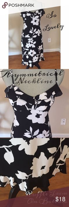 Lovely, Black & White, Floral Print Dress-EUC Black & White, Floral Print Dress w/ Spaghetti Straps-EUC Neckline is subtly asymmetrical & held with spaghetti straps The bottom of the dress has a ruffle around the hemline The dress came untagged, but seems to fit like a S, & I will be listing it as such. Fabric feels like a polyester or nylon & has quite a bit of give In EUC ‼️Due to no tags, I HIGHLY recommend you ask for measurements before purchasing & I'm happy to provide them to you‼️…