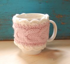 Hand knit coffee mug cozy with cable pattern and crocheted edges. €6.50, via Etsy.