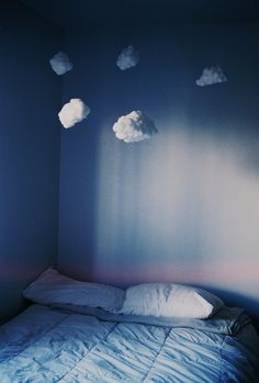 Make clouds out of stuffing, attach to fishing wire and hang from the ceiling