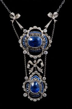 Fine early 20th Century Belle Époque sapphire & diamond necklace, the principle oval mixed cut cornflower blue sapphire estimated to weigh approx 8.66 cts, in millegrain collet setting & a border of calibre cut blue sapphires, with a further pear cut cornflower blue sapphire, approx 3.50 cts, all in millegrain setting, suspended from diamond set bows on a trace chain. In original fitted tooled leather case, by Carrington & Co., 130 Regent by Kawaii28