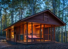 This Small Cabin Was Designed With One Big Difference - it's MOBILE, akin to a camper.  Cool.