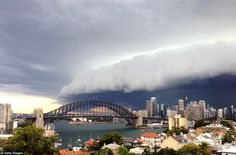 Looming: A large storm cloud covers the Sydney (Australia) Central Business District on Wednesday (6 March, 2014)