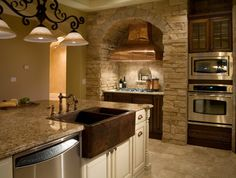 Mediterranean Kitchen pergola Design Ideas, Pictures, Remodel and Decor.   I love the copper fixtures, country sink and range hood. the Double oven is cool also. Great neutral color scheme for this space.