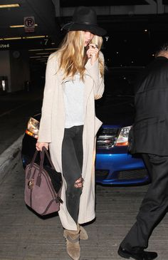 Rosie Huntington-Whiteley Ripped Jeans - Rosie Huntington-Whiteley arrived at…