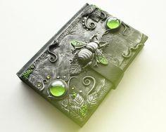 Polymer clay sketchbook with green beetle. Love the colours