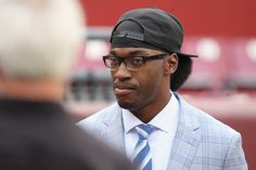 Photos: Browns vs Redskins - 1st Half  -  QB Robert Griffin III on the sideline before the Redskinsgame.