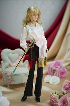 Pre-Orders Begin Soon For This Stunning Rose of Versailles Lady Oscar Doll -- Standing at approximately 27 cm (~ 10.6 in), the doll comes with two outfits, Lady Oscar's red uniform (complete with saber), and a more casual outfit.
